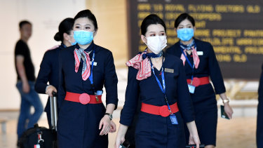 China Eastern Airlines cabin crew are seen wearing protective face masks at Brisbane International Airport on Wednesday.