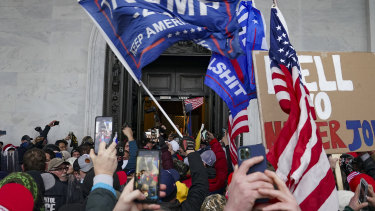 Rioters break into the Capitol in Washington.