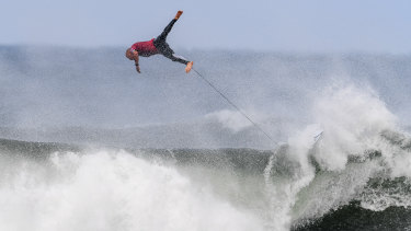 Veteran Kelly Slater bails out on a wave.