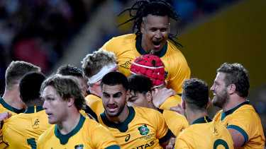The Wallabies celebrate a try against the All Blacks last year.