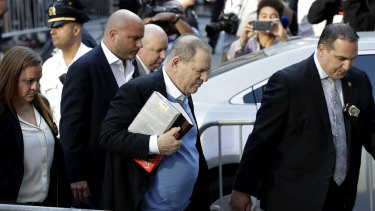 Earlier: Harvey Weinstein turning himself in to authorities following allegations of sexual misconduct.