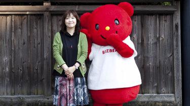 Hiromi Kano with a mascot made by Kigurumi.biz, her factory in Miyazaki, Japan, November.
