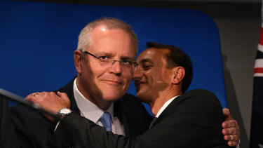 Prime Minister Scott Morrison embraces Liberal candidate Dave Sharma prior to his concession speech.