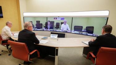 Prime Minister Scott Morrison speaks to NSW Premier Gladys Berejiklian in the national cabinet meeting on Sunday.
