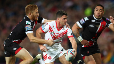 Lachlan Coote (centre) in action during St Helens' Super League triumph over Salford.
