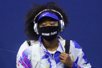 All masked up and coming to Australia: Naomi Osaka in the quarter-finals of the US Open in September.