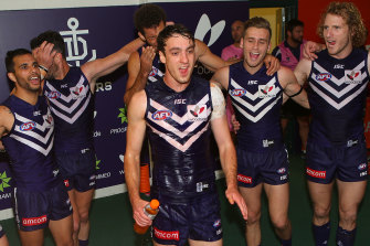 Max Duffy, pictured here enjoying his first win for Fremantle in 2014, is a former Docker.