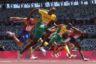 Hansle Parchment of Jamaica wins the men's 110-metre hurdles.