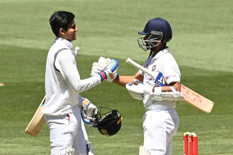 Shubman Gill and Ajinkya Rahane celebrate after India's victory in the second Test on Tuesday.