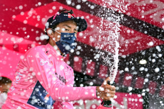 Egan Bernal celebrates after retaining the pink jersey on the 20th stage.