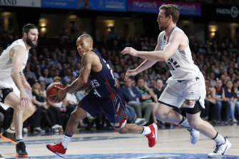 Adelaide's Jerome Randle drives past Melbourne's Mitch McCarron.