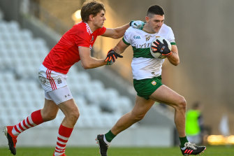 Colin O'Riordan is tackled by Ian Maguire in Cork.