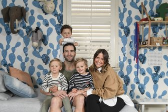 Lucy and Jordan Lewis with their sons, twins Ollie and Hughie, and Freddie. They followed a sleeping method for the twins recommended by Melbourne paediatrician Dr Daniel Golshevsky with great success.