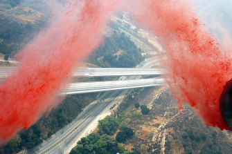 A C-130 Hercules drops fire retardant over southern California.