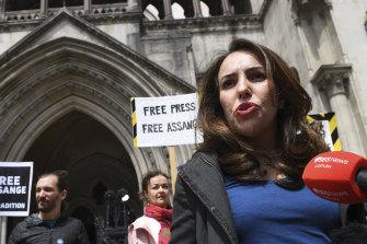 Julian Assange's partner, Stella Moris speaks to the media outside the High Court in London on Wednesday.