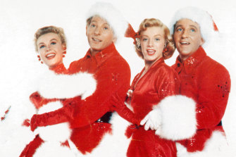 Vera-Ellen, Danny Kaye, Rosemary Clooney and Bing Crosby in a scene from the 1954 movie <i>White Christmas</i>.