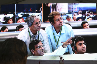 Indian Space Research Organisation scientists watch a screen at their Telemetry, Tracking and Command Network facility in Bangalore on Saturday as the spacecraft approached the moon.