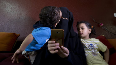Muna Awad with two of her children at the family home.