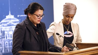 lhan Omar, right, consoles Rashida Tlaib during a news conference in Minnesota on Monday, local time.