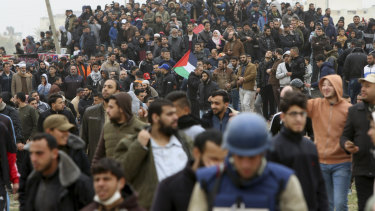 Tens of thousands of protesters gather near the Gaza Strip's border with Israel on Saturday, March 30.