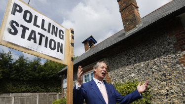 Brexit Party leader Nigel Farage outside a polling station on Thursday.