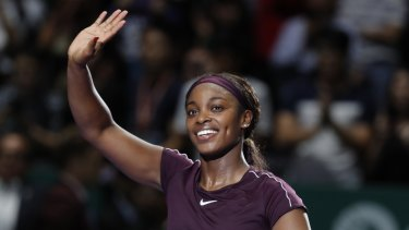 All smiles: Sloane Stephens waves to the crowd after beating Naomi Osaka in Singapore.