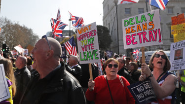 Crowds protested in Parliament Square as May's deal was defeated.