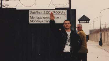 Former neo-Nazi turned author and deradicalisation expert Christian Picciolini in Nazi garb at the Dachau gate in about 1992.
