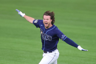 Brett Phillips celebrates his team's unlikely walk-off victory.