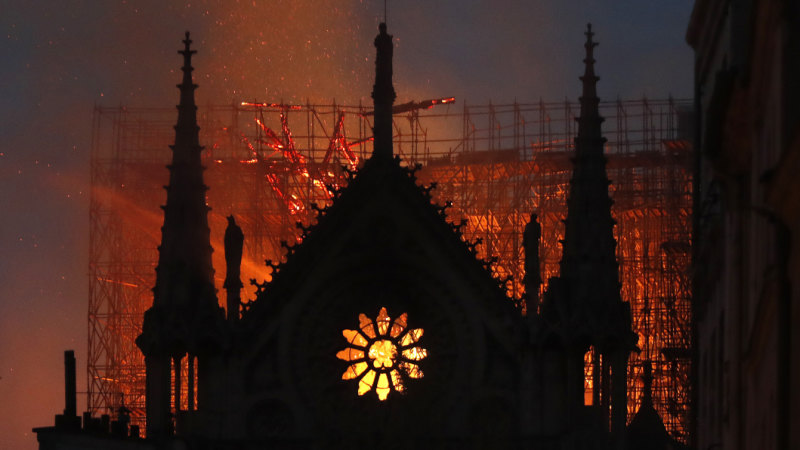 Notre Dame engulfed in flames as firefighters battle to save it