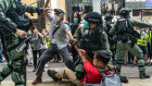 Pro-democracy supporters scuffle with riot police during a rally in Causeway Bay district on Wednesday. Hong Kong is becoming as authoritarian as the mainland.