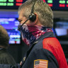 Wall Street slips from record highs as inflation surprises