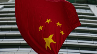 Chinese flag flies outside the Office for Safeguarding National Security of the Central People's Government in the Hong Kong.