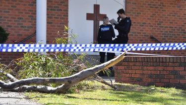 The fallen tree branch outside St John Vianney Church.