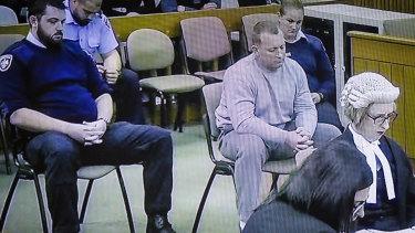 Graham Dillon as Justice John Burns sentenced him to decades in jail.