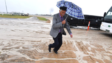 Racegoers faced a heavy track at Flemington on Cup Day last year.