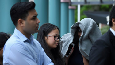 Tina Phan (middle) arrives at Burwood Local Court on Thursday.