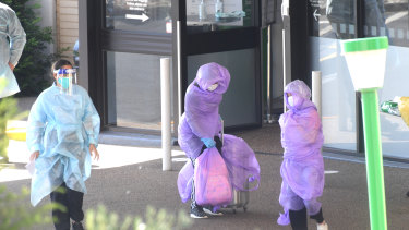 Patients were covered in plastic to be transported from the Holiday Inn to the Pullman Hotel.