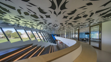 The main auditorium features a laser cut MDF ceiling with a floral motif.