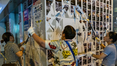 """A pro-Beijing city legislator, Junius Ho, who has been a vocal critic of the protests, had urged his supporters to clean up the approximately 100 """"Lennon Walls"""" around the city."""