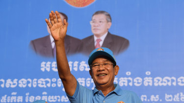 Prime Minister Hun Sen greets the crowd at the last Cambodian People's Party rally before the election.