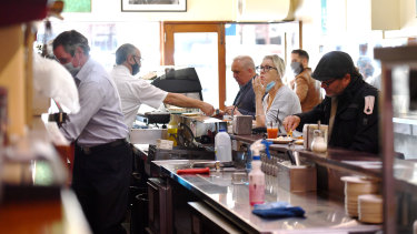 Customers eating at Pellegrini's Espresso Bar for the first time in months.