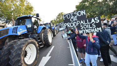 Trucks block central Werribee in demonstration against a plan to dump contaminated soil near homes.