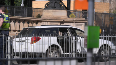 The station wagon remains outside Parliament House in Spring Street.