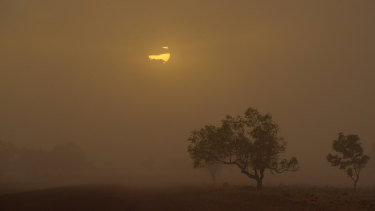 Hot and dry: a dust storm near Bourke on the evening of January 17. The region recorded Australia's highest minimum temperature, 36.6 degrees.