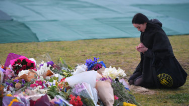 A woman pays her respects.