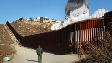 "JR's 21-metre-high installation of a child, ""Kikito"", peers over the wall that partitions Mexico from the US."