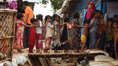 Rohingya children queue for vaccinations at a UNICEF nutrition centre in Balukhali Camp.