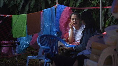 Relatives of the trapped boys await their rescue at the base camp near Tham Luang cave.