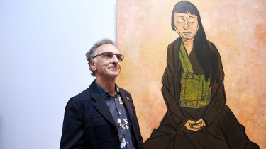 Winner of the 2019 Archibald Prize, artist Tony Costa, in front of his winning portrait titled Lindy Lee on Friday. (Full image below.)